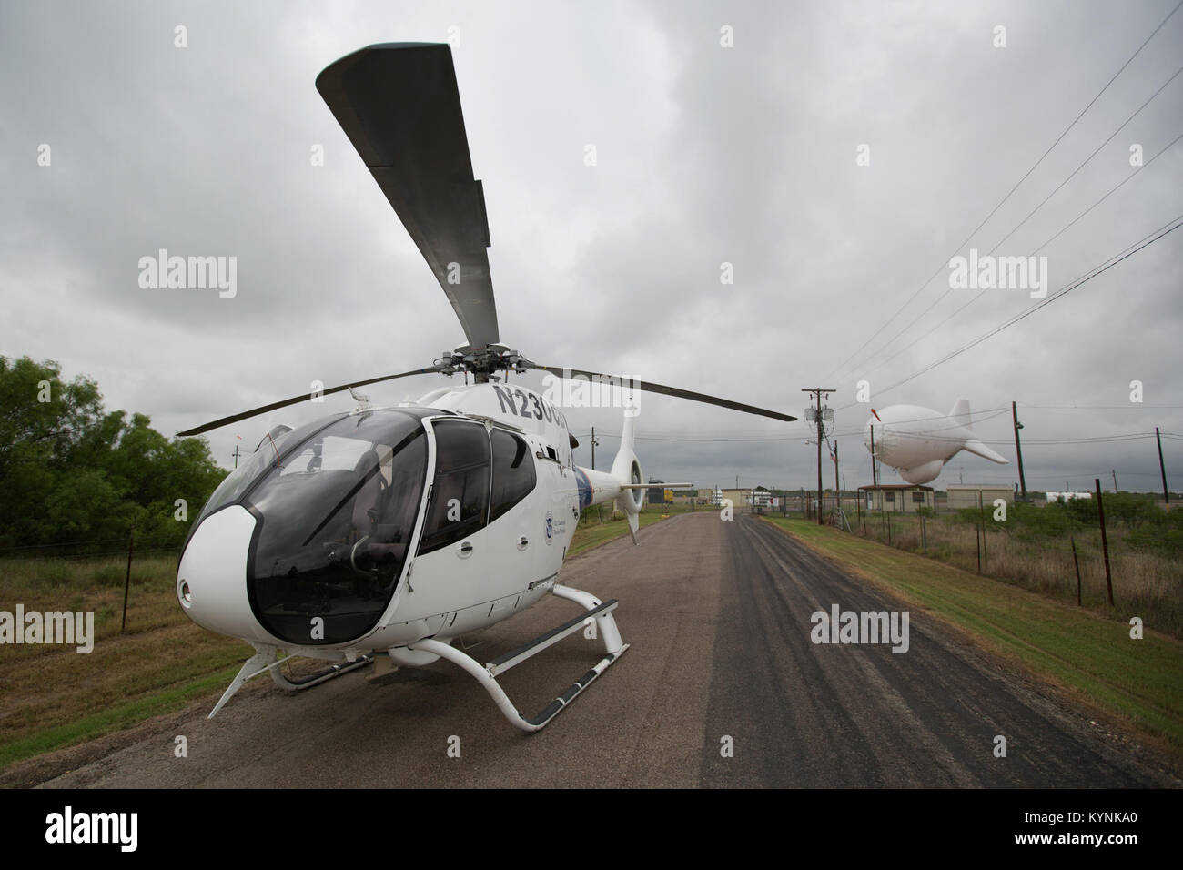 Eagle Pass, TX - An EC-120 helicopter outside the gate of an aerostat site in Eagle Pass, TX.  The Tethered Aerostat Stock Photo