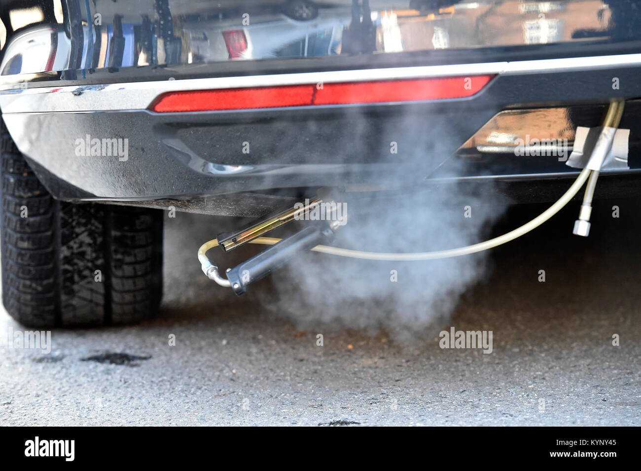 Measuring devices and probes are ready for the measurement of pollutants at an exhaust pipe of a car with a 150 - Stock Image