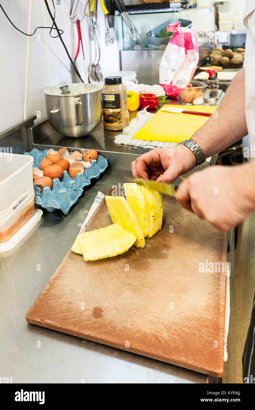 Food preparation - food being prepared in a restaurant kitchen. - Stock Image