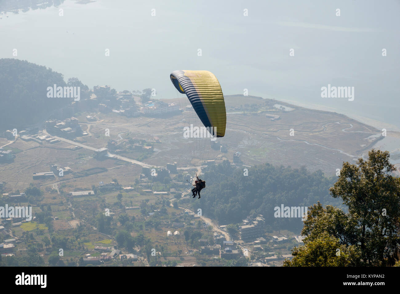 Tandem paragliding at Sarankot over Phewa Lake, Pokhara, Nepal - Stock Image