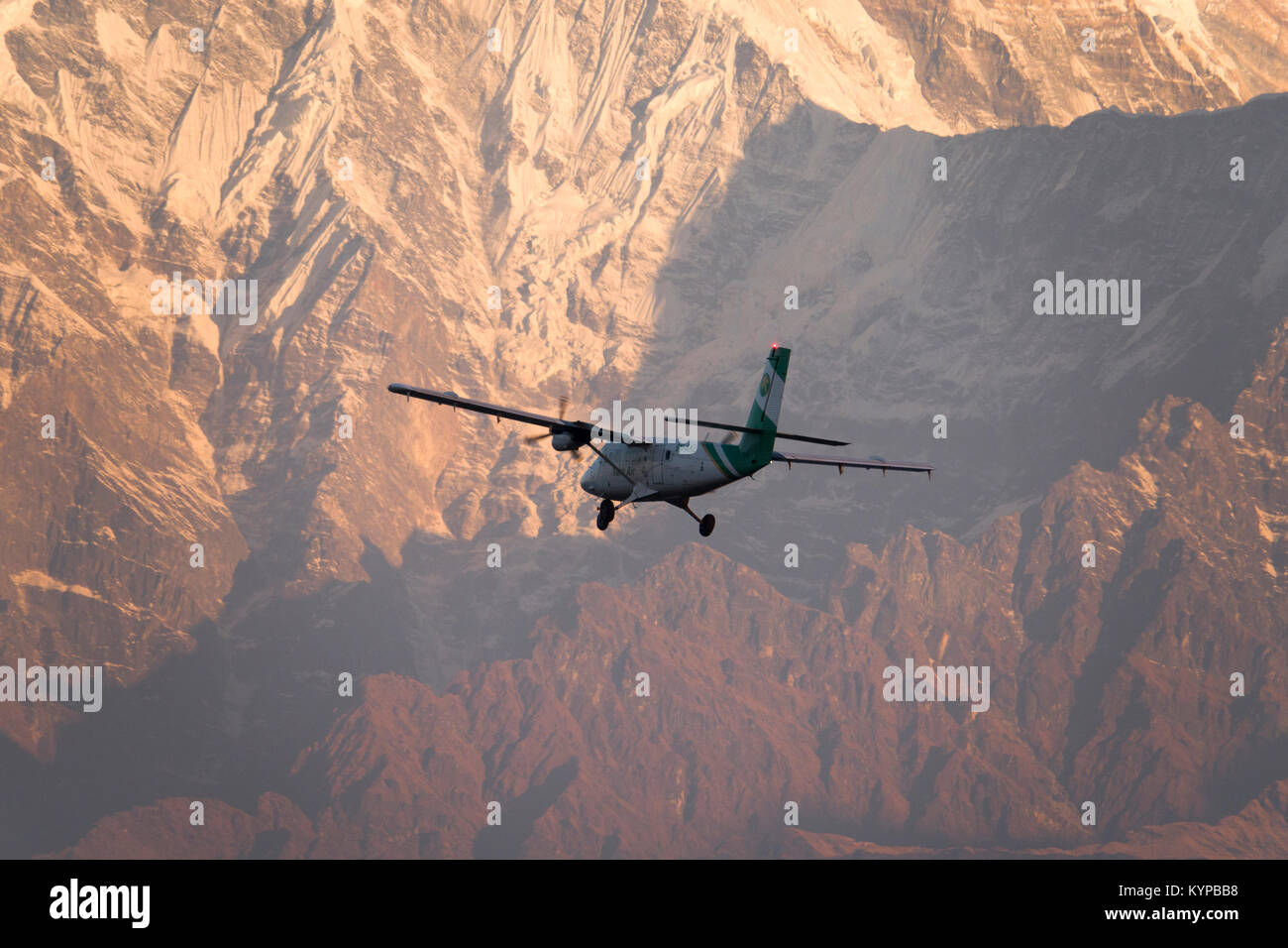 Tourist plane on sightseeing flight over the Annapurna mountains in Nepal - Stock Image