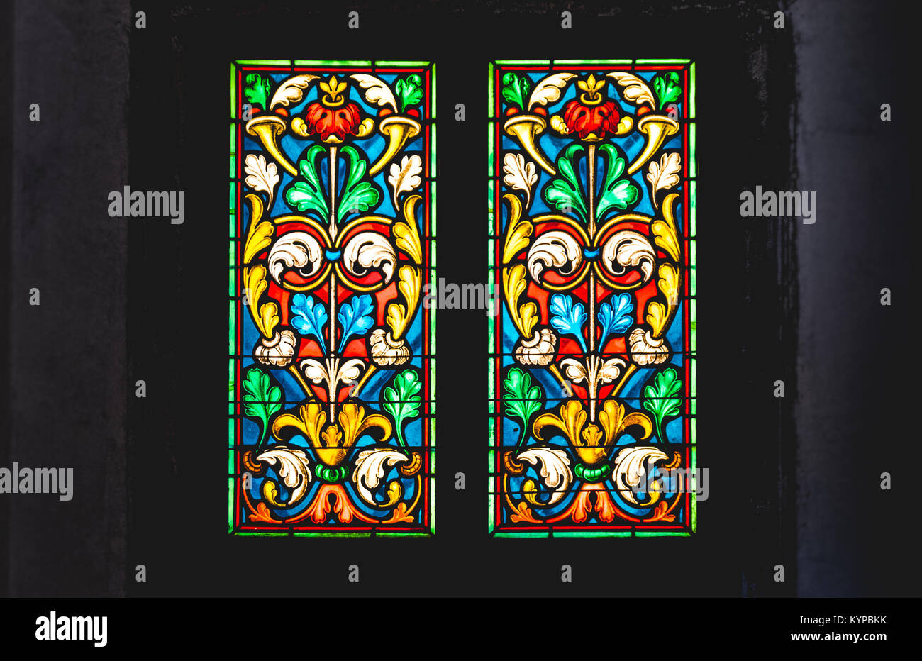 coloured stained glass in dark background Stock Photo