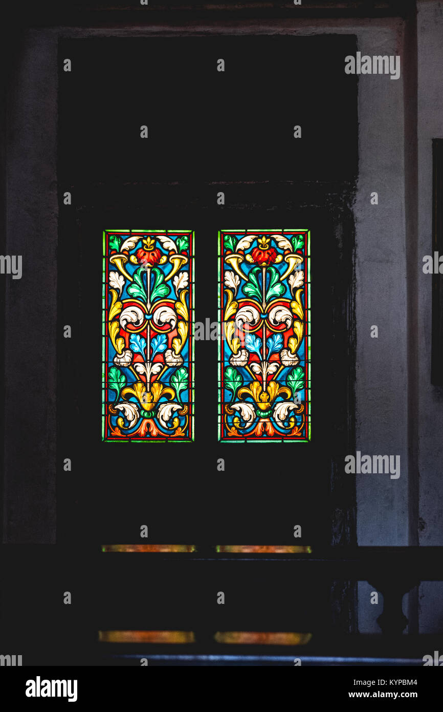 church coloured stained glass in the dark Stock Photo