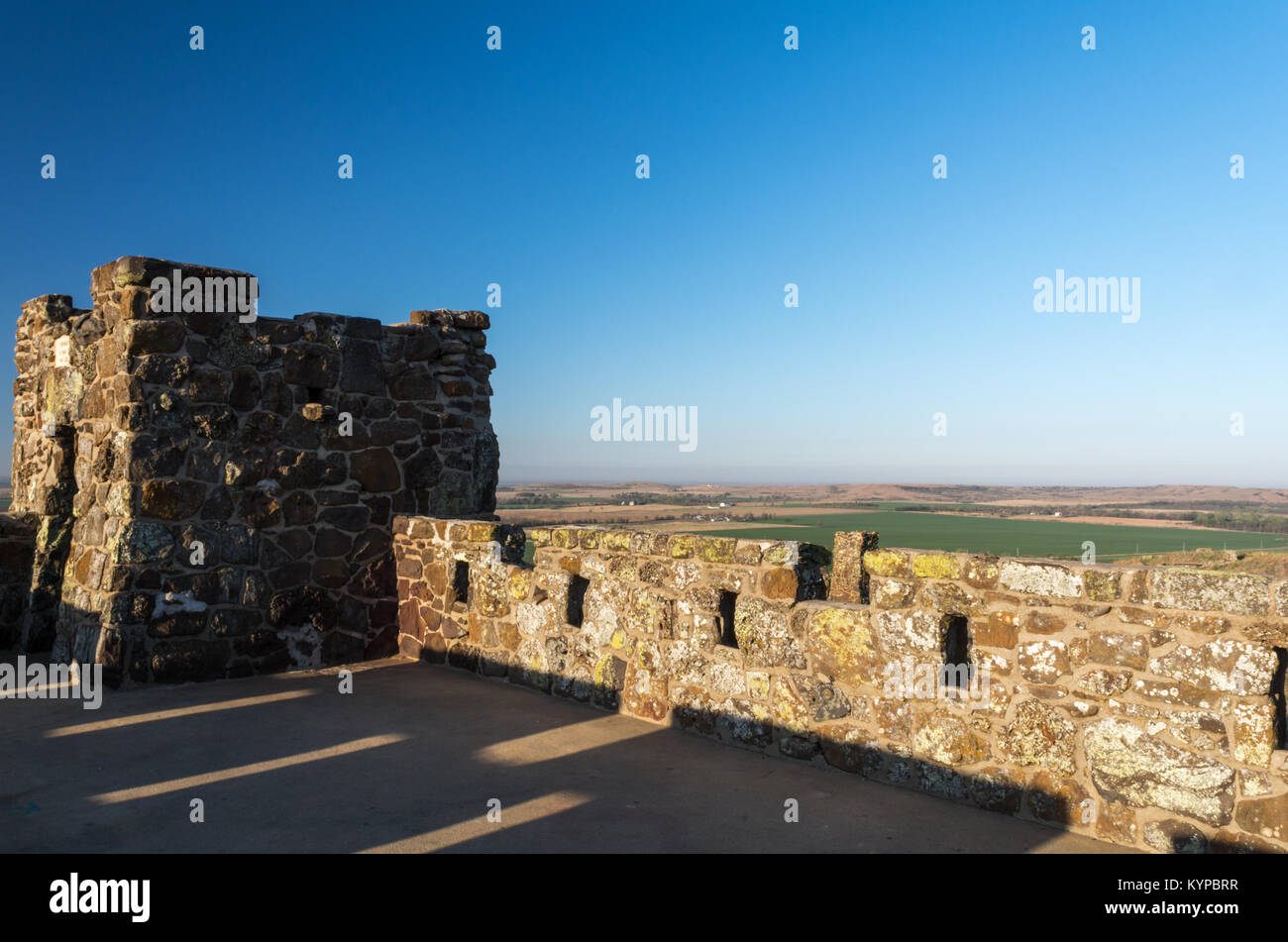 Dawn's shadow keep across the roof of a castle in Kanas. - Stock Image