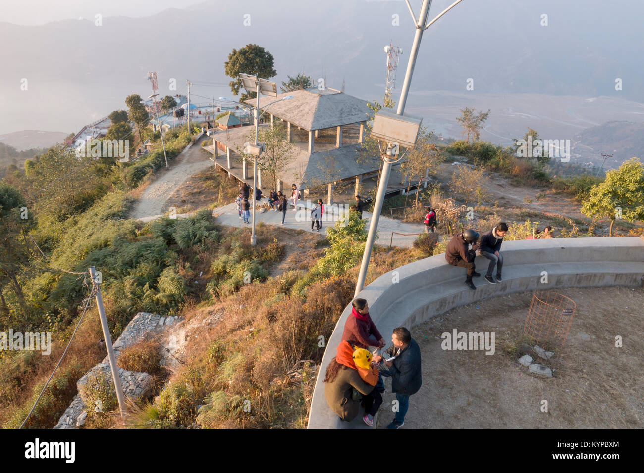 People descend the lookout just after sunrise at Sarankot, Pokhara, Nepal - Stock Image