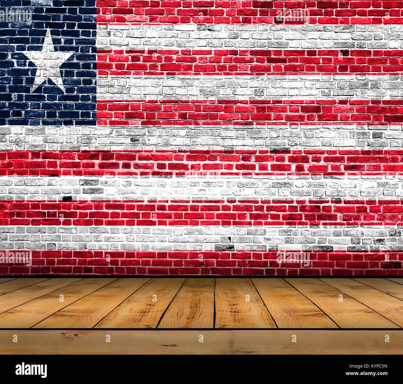 Liberia flag painted on brick wall with wooden floor - Stock Image