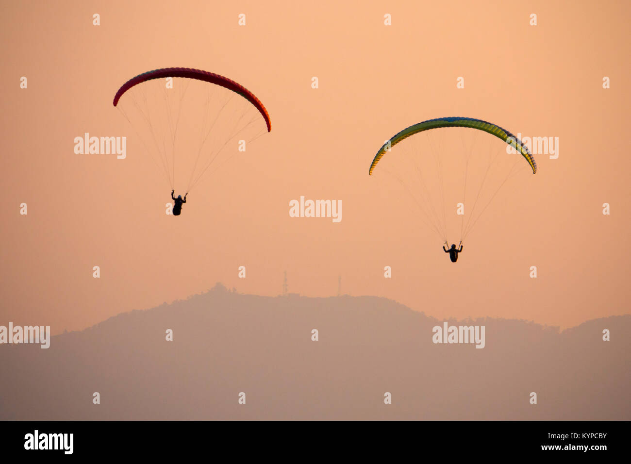 Paragliding at sunset in Pokhara, Nepal Stock Photo