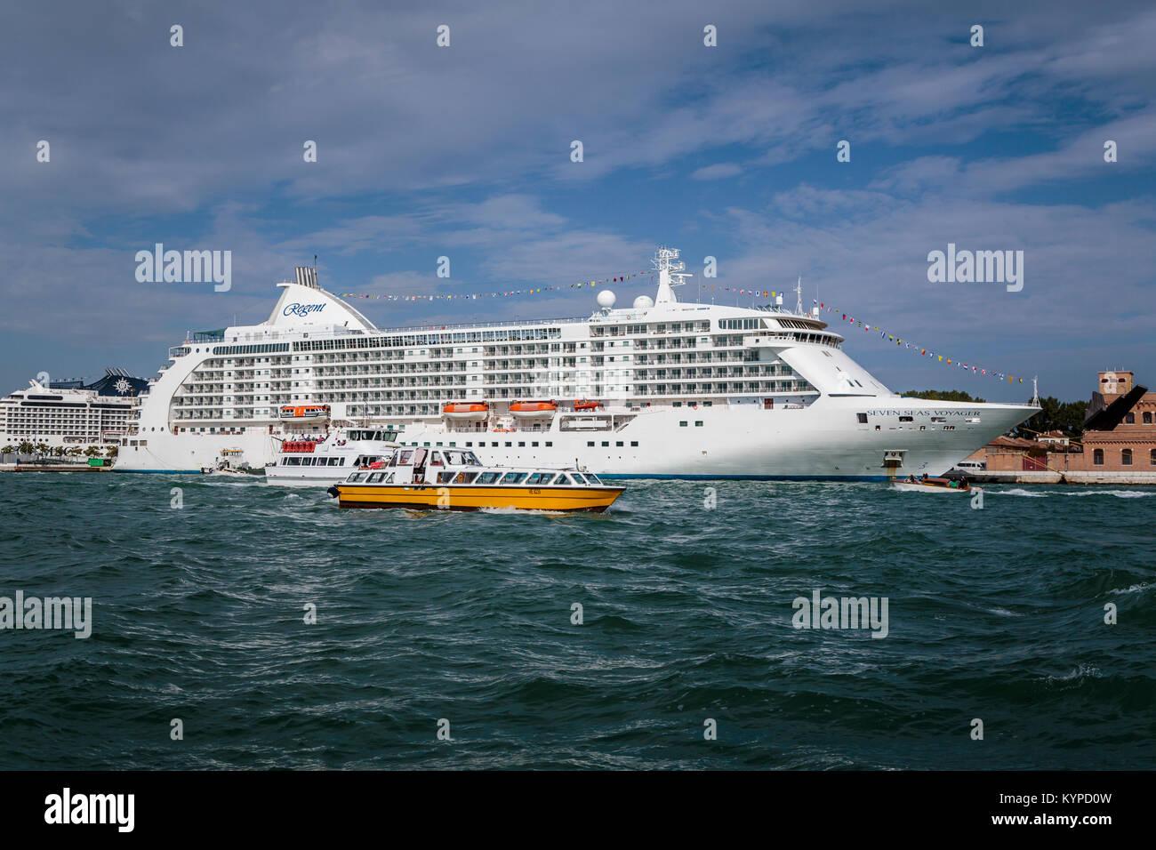 The Seven Seas Voyager Regent cruise ship docked in port in Veneto, Venice, Italy, Europe. - Stock Image