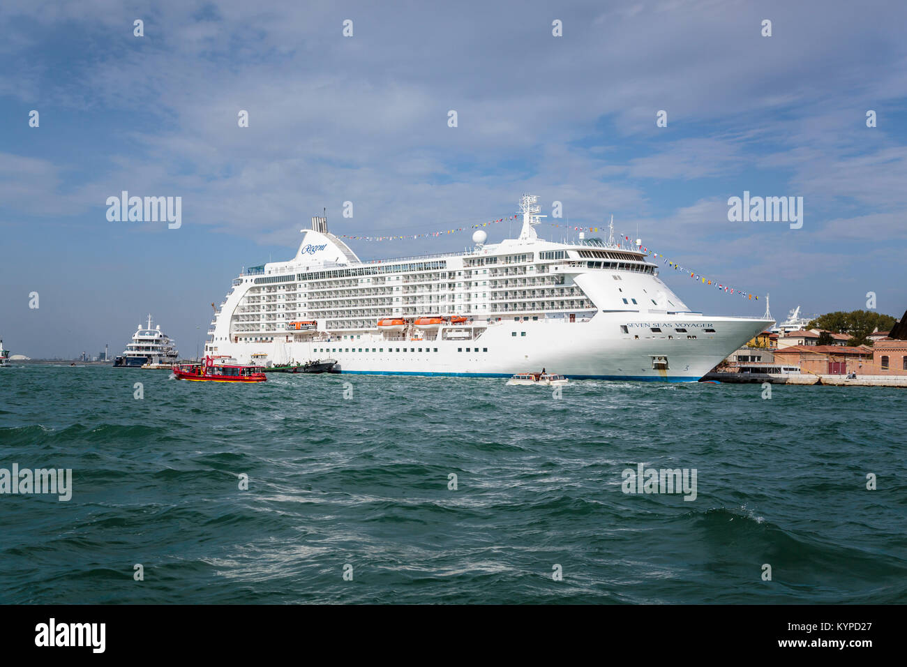 The Seven Seas Voyager Regent cruise ship docked in port in Veneto, Venice, Italy, Europe. - Stock Image