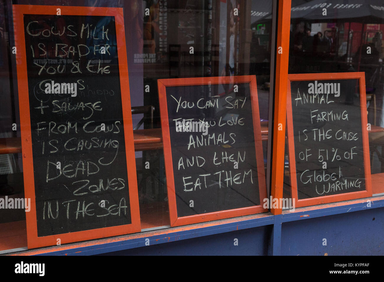London, UK. 13th January, 2018. Messages written on blackboards positioned in the windows of a vegan restaurant - Stock Image