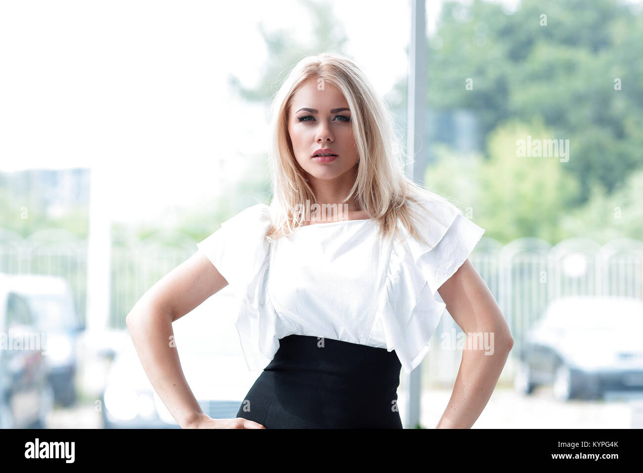 portrait of modern business woman in blurred background office. - Stock Image