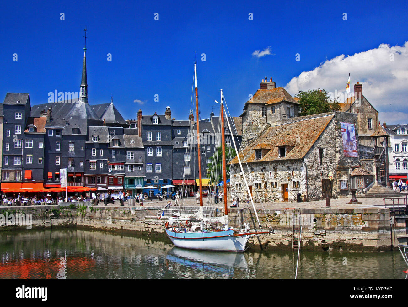 Sailing boat in the harbour and waterfront at Honfleur Normandy in Northern France - Stock Image