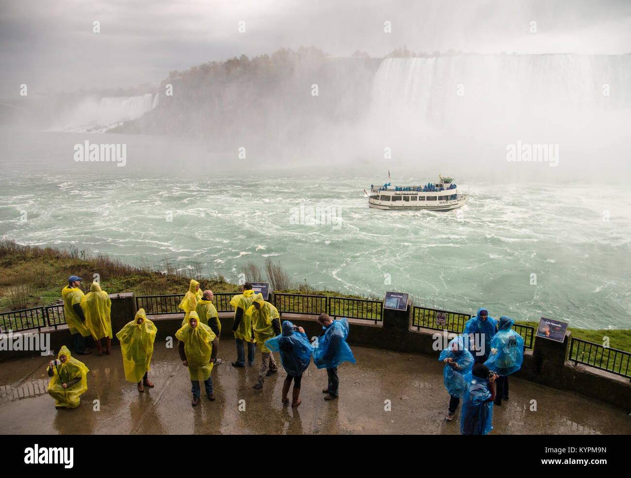 Maid of the Mist in Niagara River from viewing platform at Journey Behind the Falls attraction in Niagara Falls, - Stock Image
