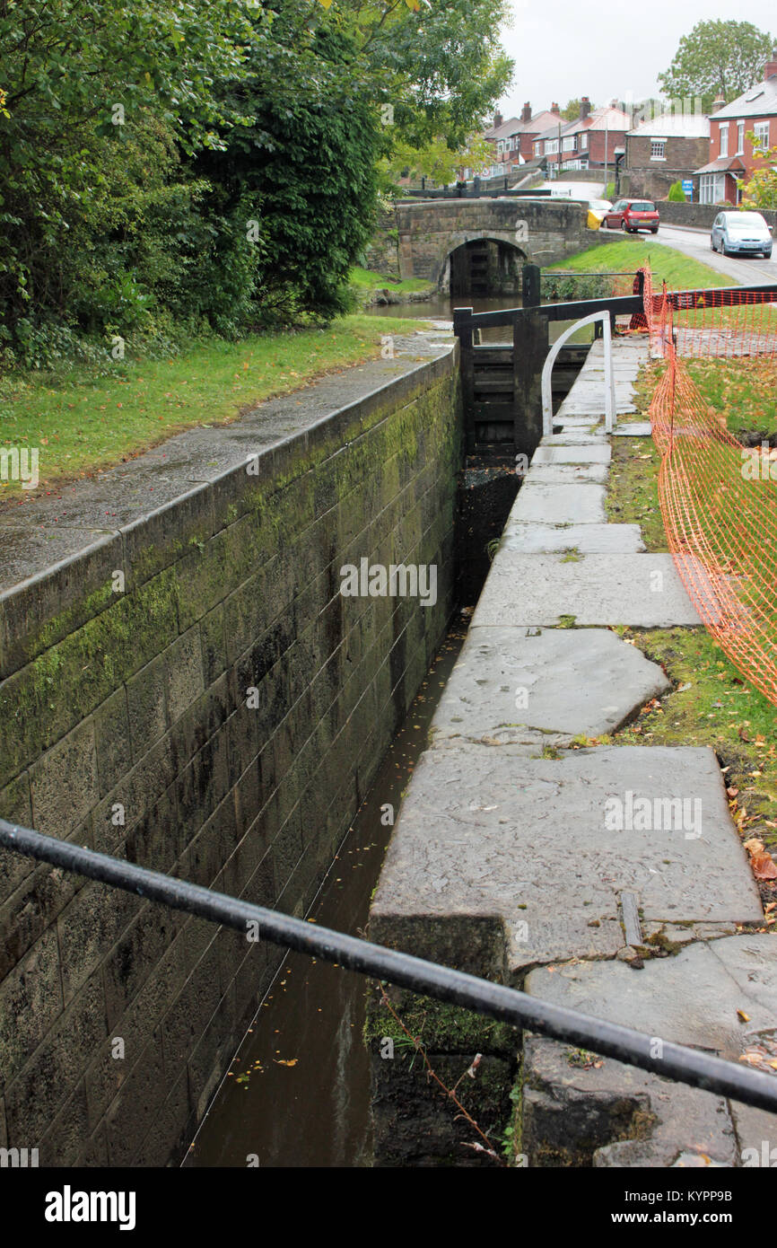 The wall on one side of a lock on the Marple flight has moved inwards and needs rebuilding as the lock is now to - Stock Image