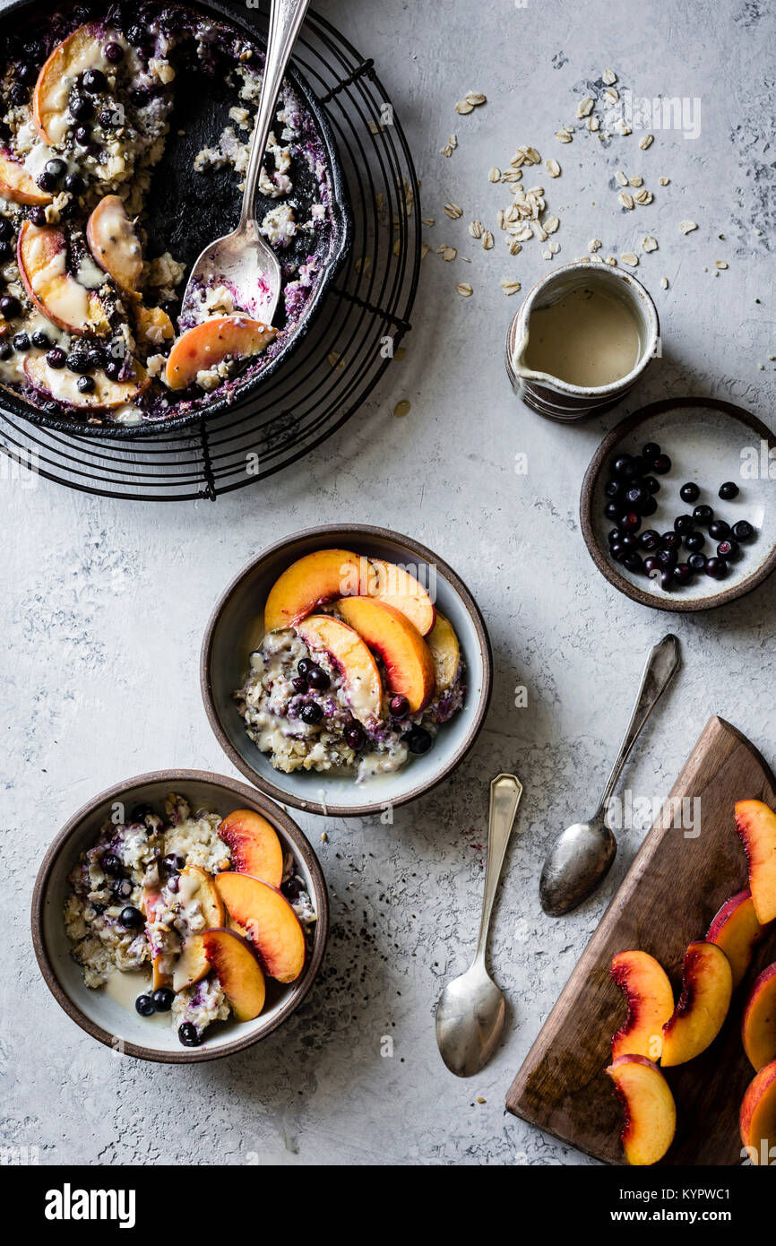 Super seedy vegan baked oatmeal with peaches and huckleberries - Stock Image