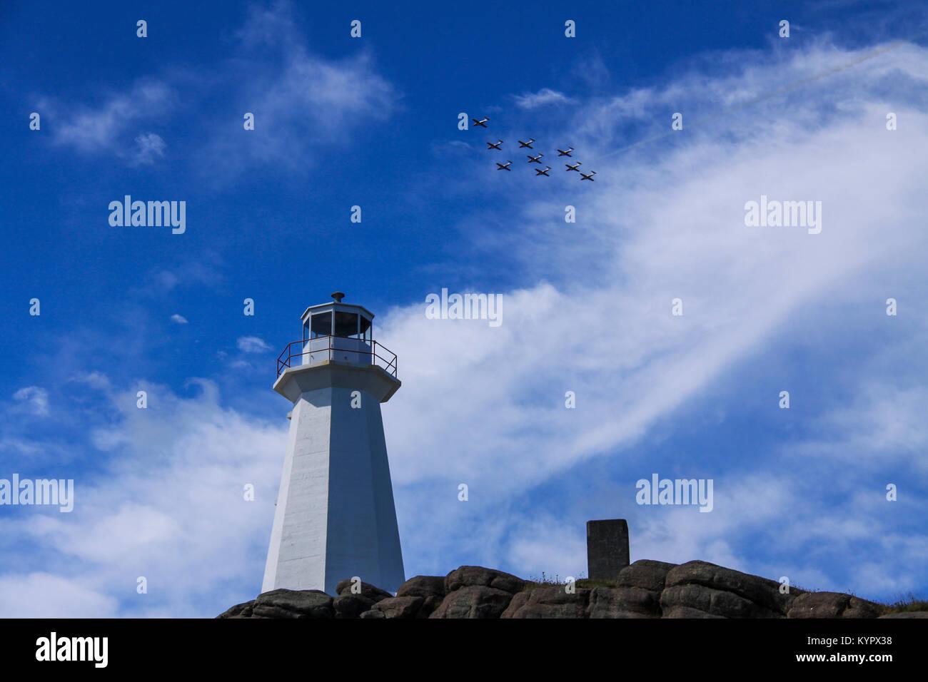 The Snowbirds fly over Cape Spear, Newfoundland. - Stock Image