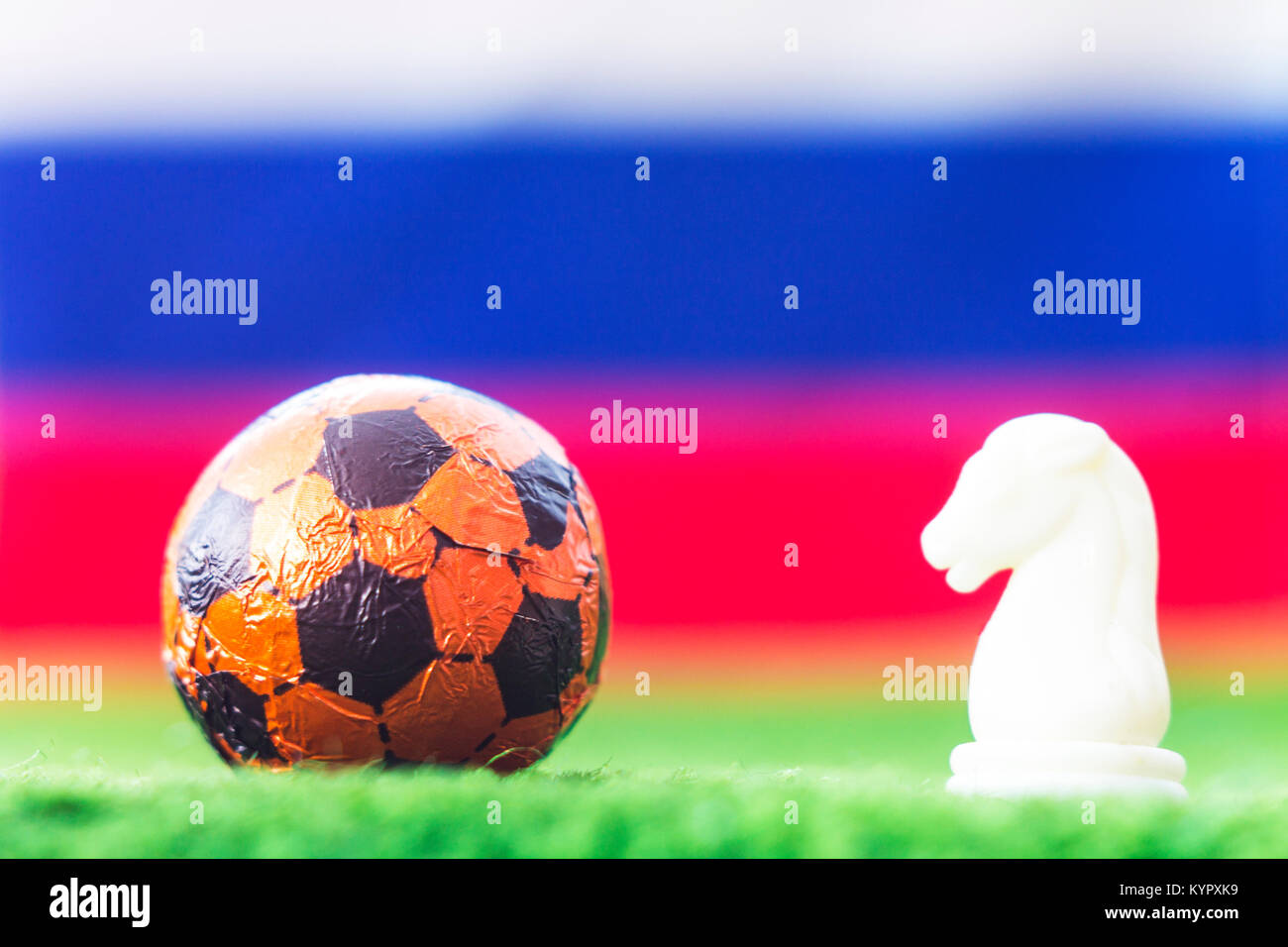 Russia Flag Chess as a football. FIFA World Cup 2018.Ball and white figure on the green grass. - Stock Image