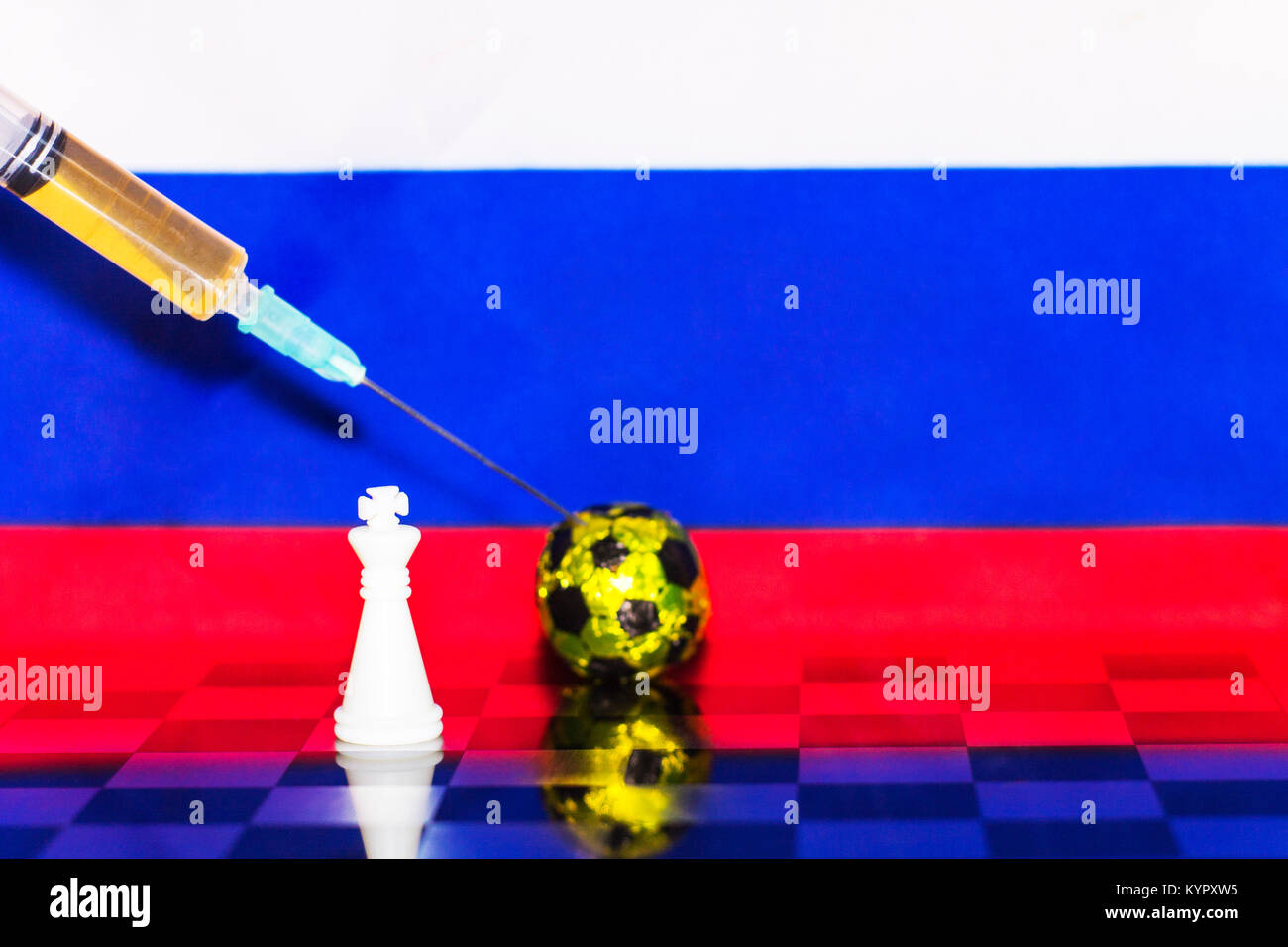 Russia Flag Chess as a football. FIFA World Cup 2018. A white figure near the golden ball and a syringe with doping. - Stock Image