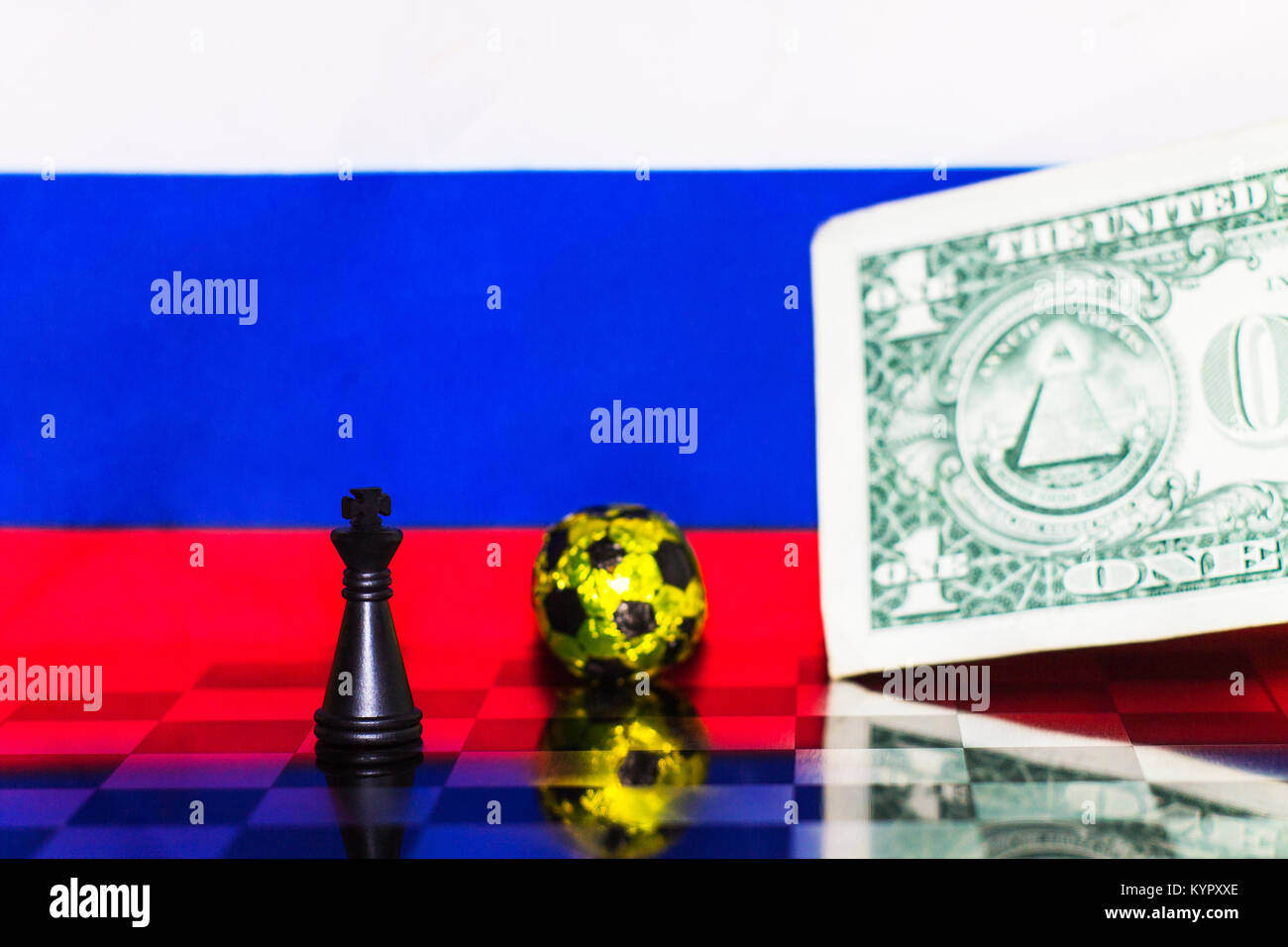 Russia Flag Chess as a football. FIFA World Cup 2018. Black figure at the golden ball and a money for a bribe. - Stock Image