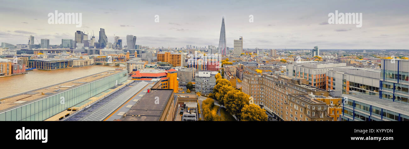 Panoramic aerial view with the Shard, skyscrapers of the City of London and London skyline on a gloomy overcast - Stock Image