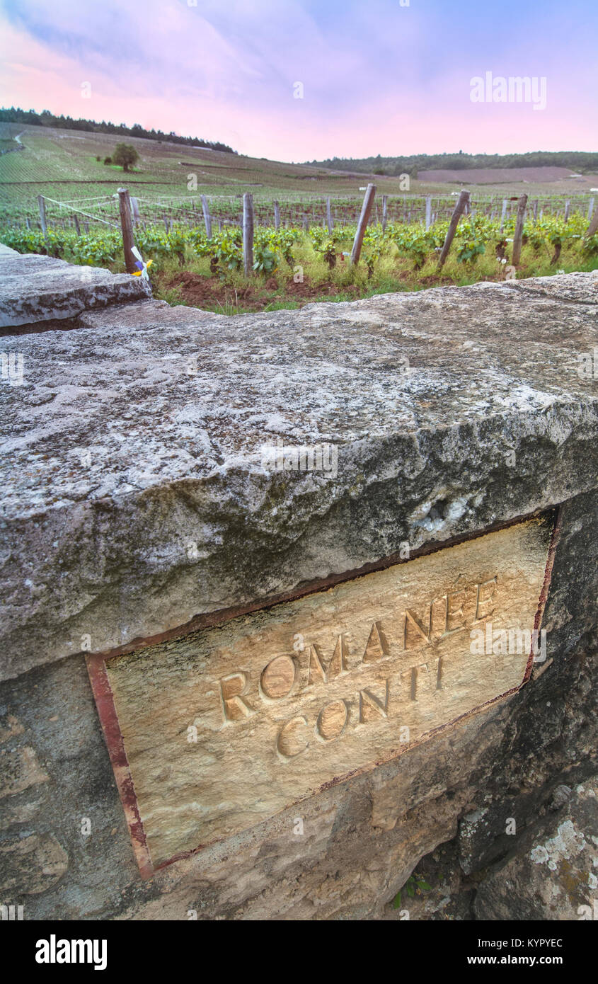 Engraved stone plaque 'Romanee-Conti'  in boundary wall of historic revered fine luxury red Burgundy Pinot - Stock Image