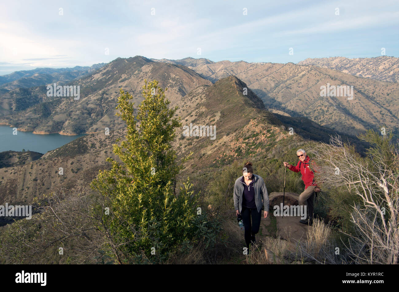 Two hikers navigate the Blue Ridge Loop overlooking Lake Berryessa. Stock Photo