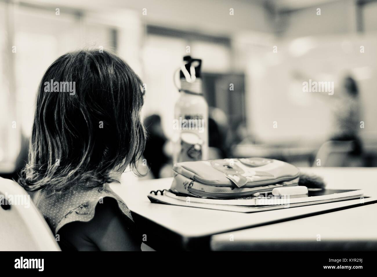 Young girl student in a classroom with teacher in background, James Cook University, Townsville, Queensland, Australia Stock Photo
