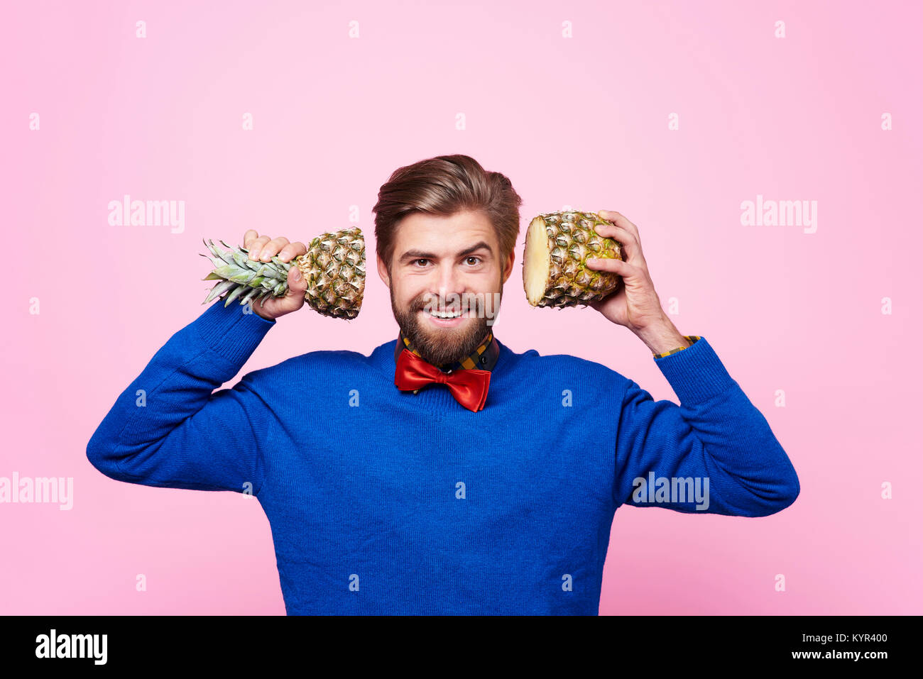 Front view of man  posing with fruit - Stock Image