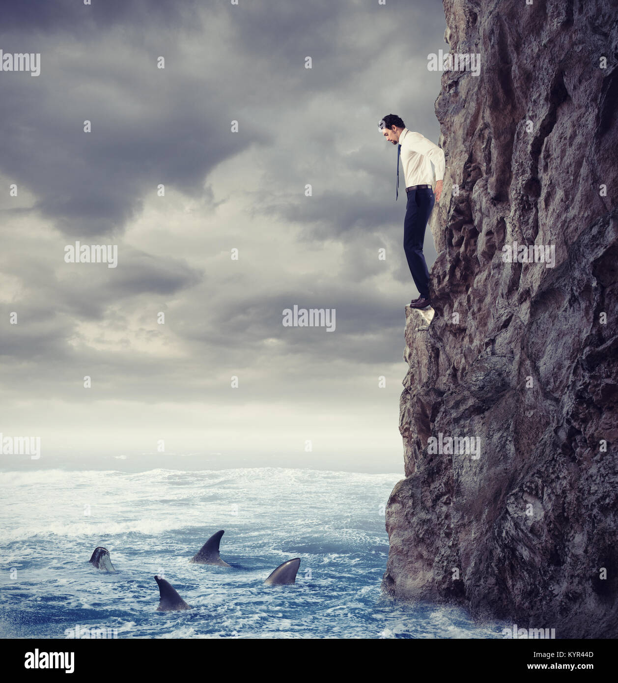 Businessman is likely to fall into the sea with shark. Risks and difficulties concept - Stock Image