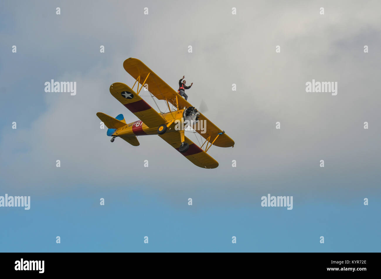 In The Sky, Portrush, Northern Ireland - August 31, 2013:-  An Unknown male is Wing Walking on an old Bi Plane at Stock Photo
