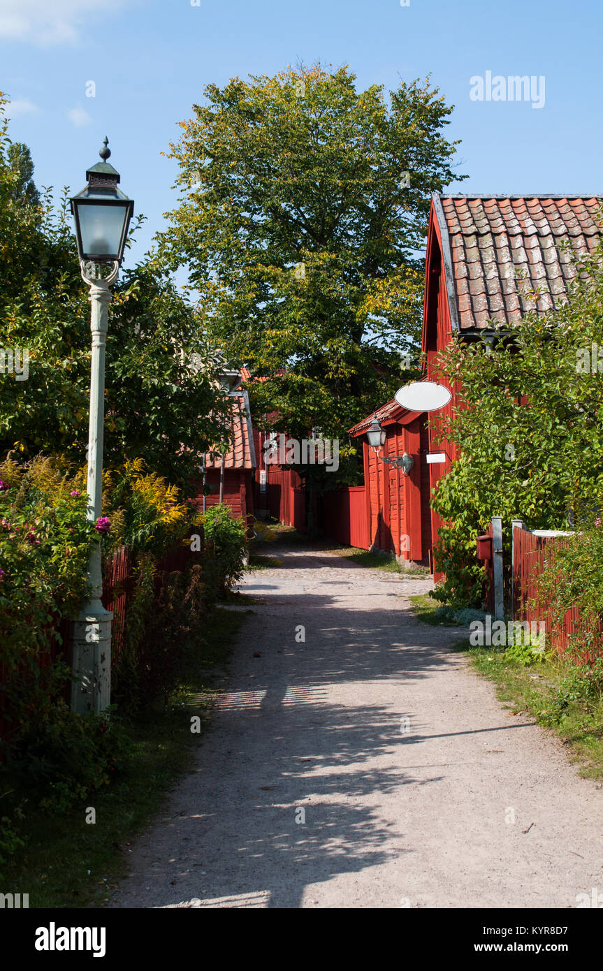 Small idyllic road leading to swedish shop in old town Linkoping - Stock Image