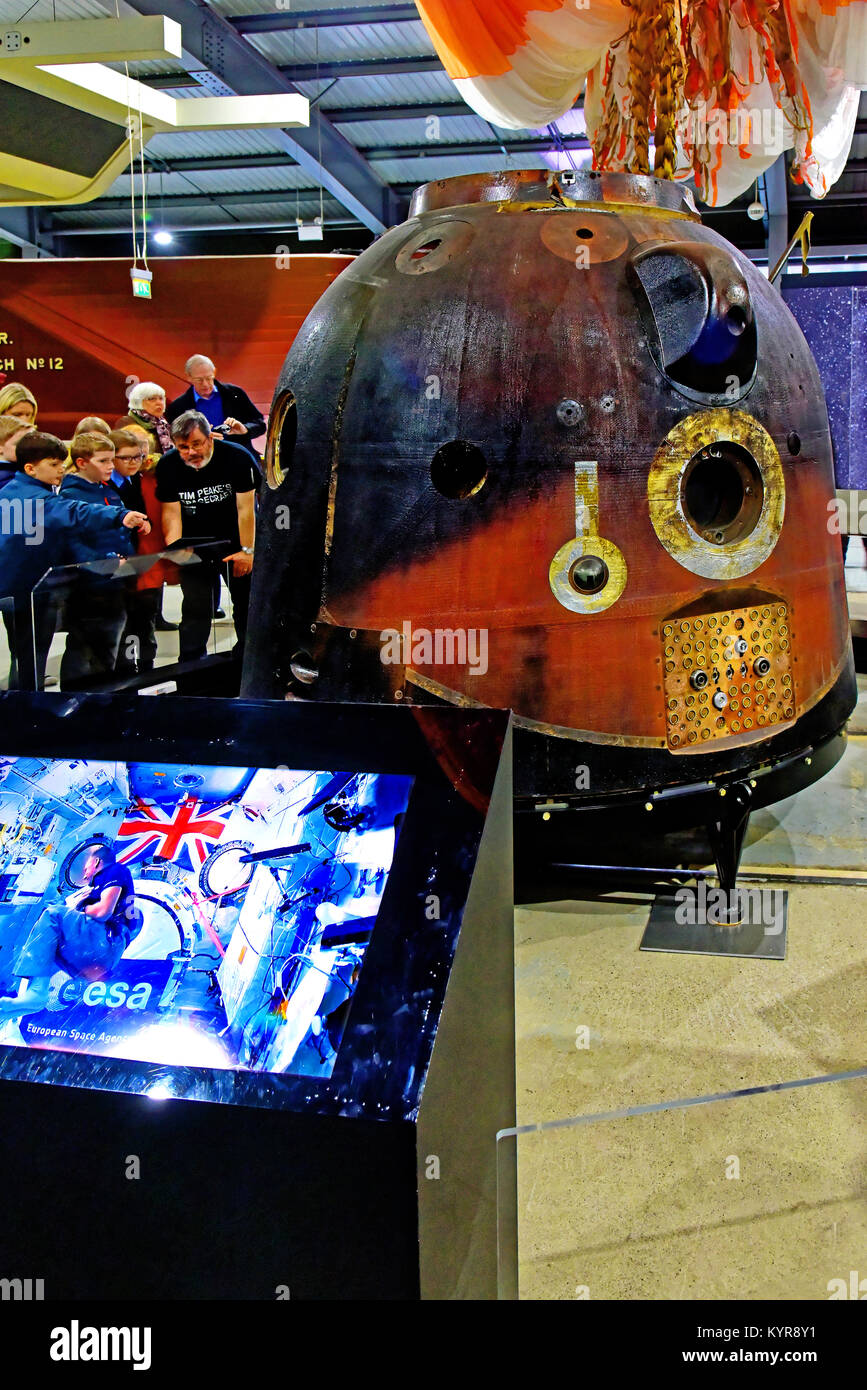 Tim Peakes Soyuz Russian Space Craft capsule and eager school children Shildon Railway Museum - Stock Image