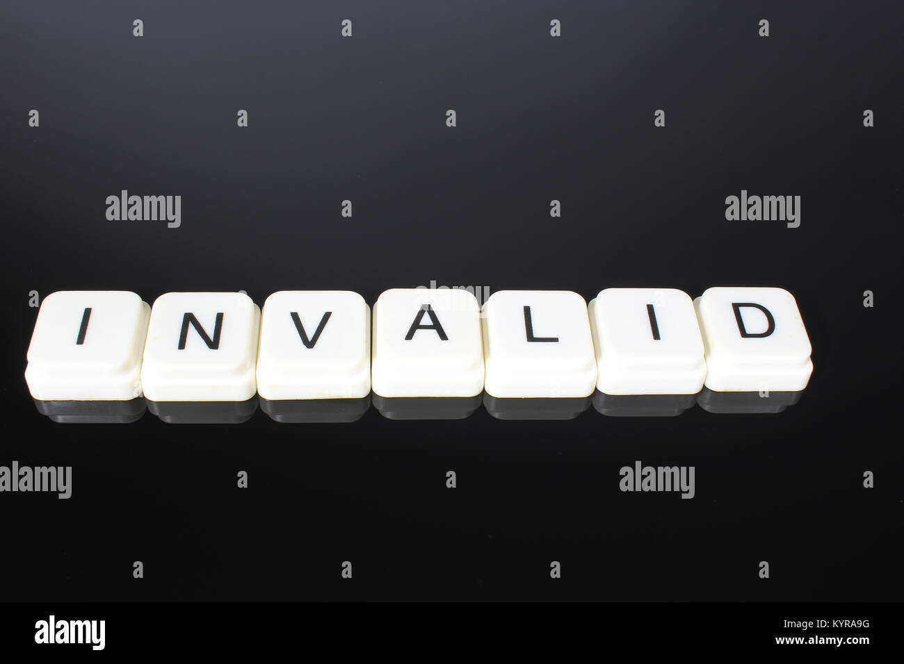 Invalid text word title caption label cover backdrop background. Alphabet letter toy blocks on black reflective - Stock Image