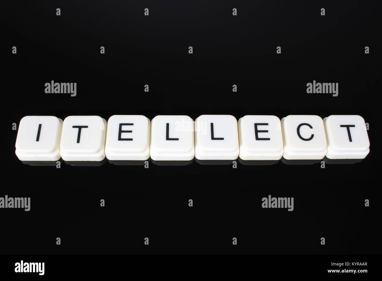 Intellect text word title caption label cover backdrop background. Alphabet letter toy blocks on black reflective - Stock Image