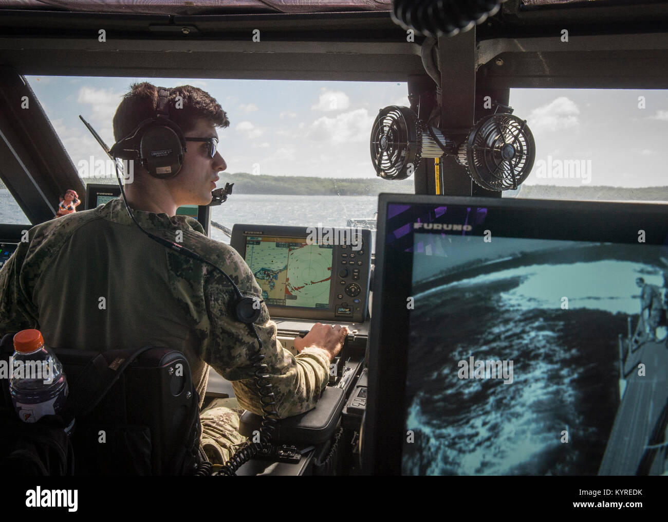 us navy quartermaster 3rd class zachary rice assigned to coastal riverine squadron crs 2 coxswains a mk vi patrol boat during training in support of