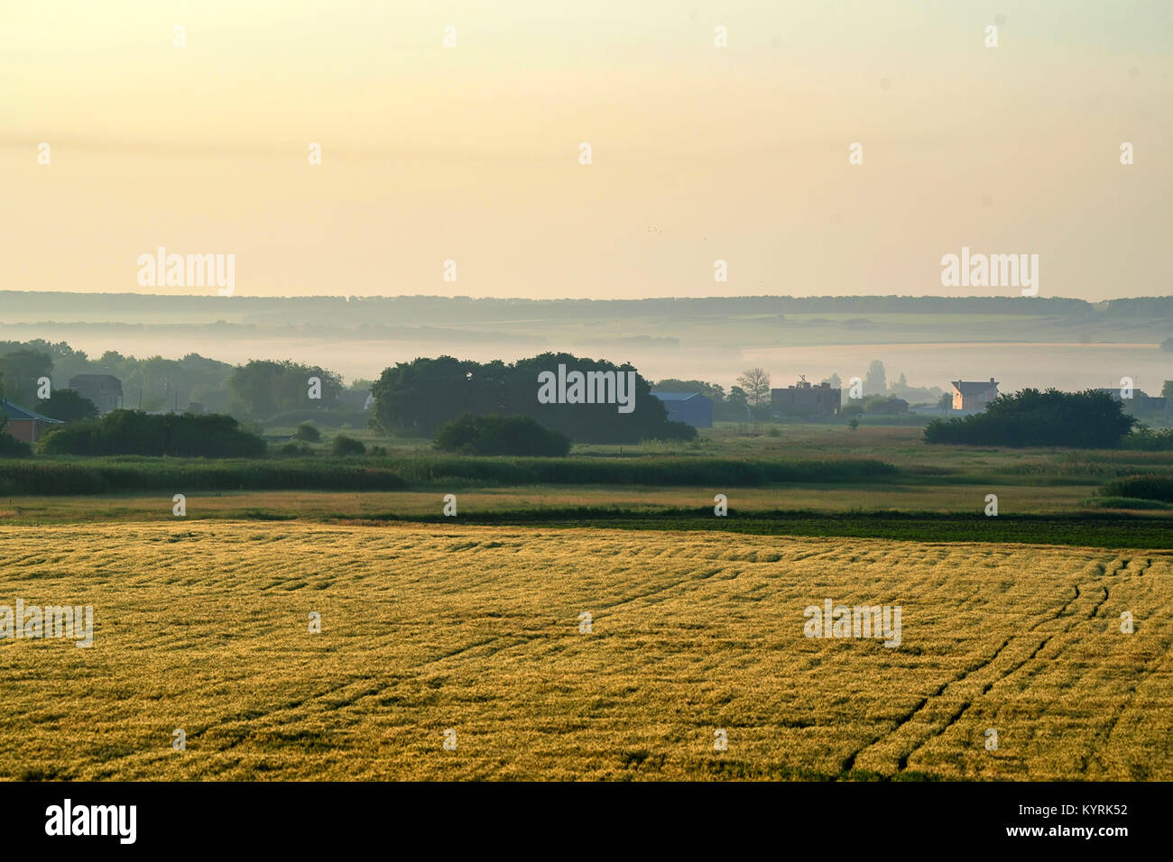 Beautiful view of misty sunrise in valley - Stock Image
