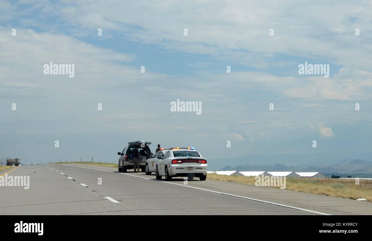 utah highway patrol officers stop and search car on roadside - Stock Image