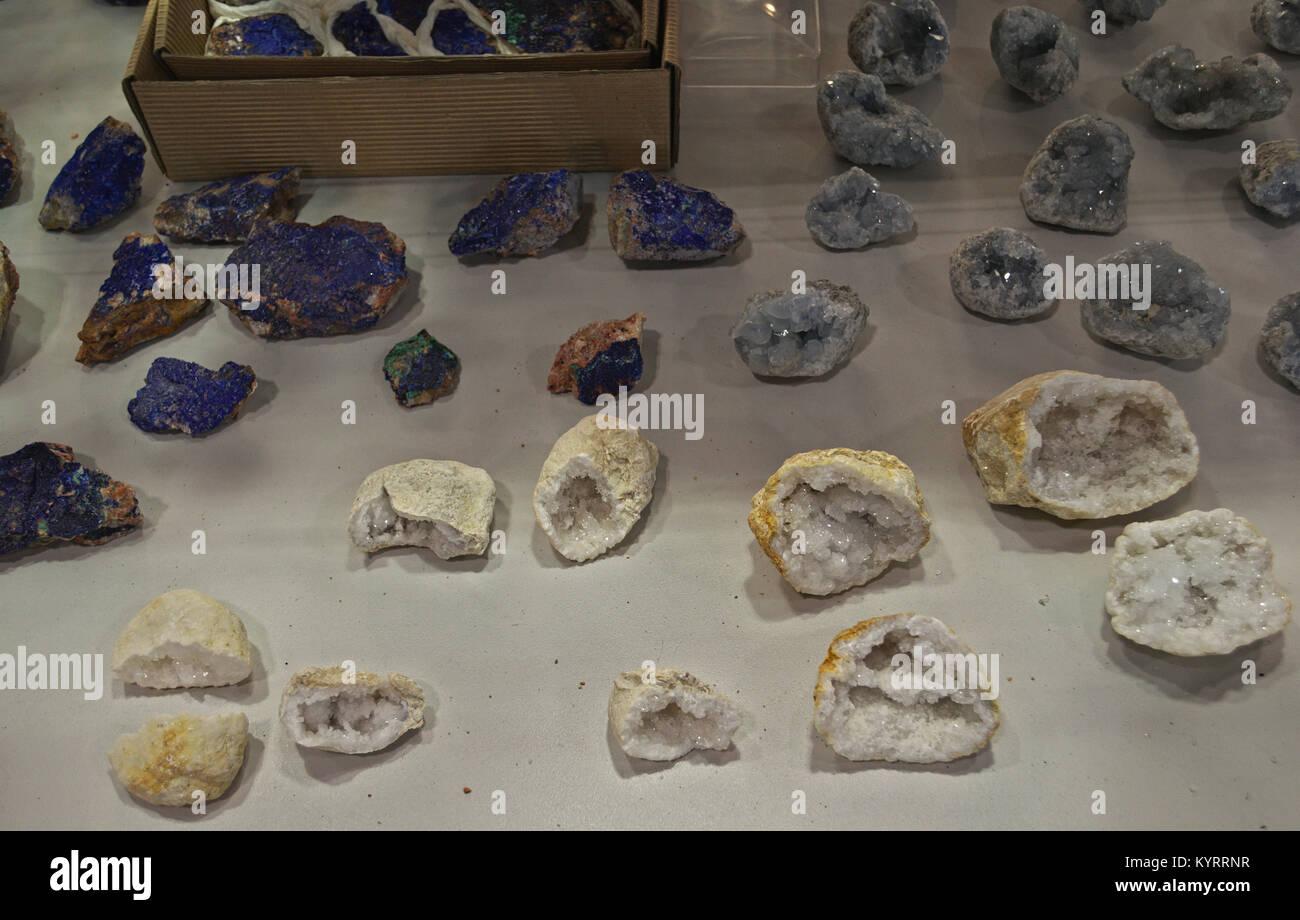 Various semi precious stones displaying on table - Stock Image