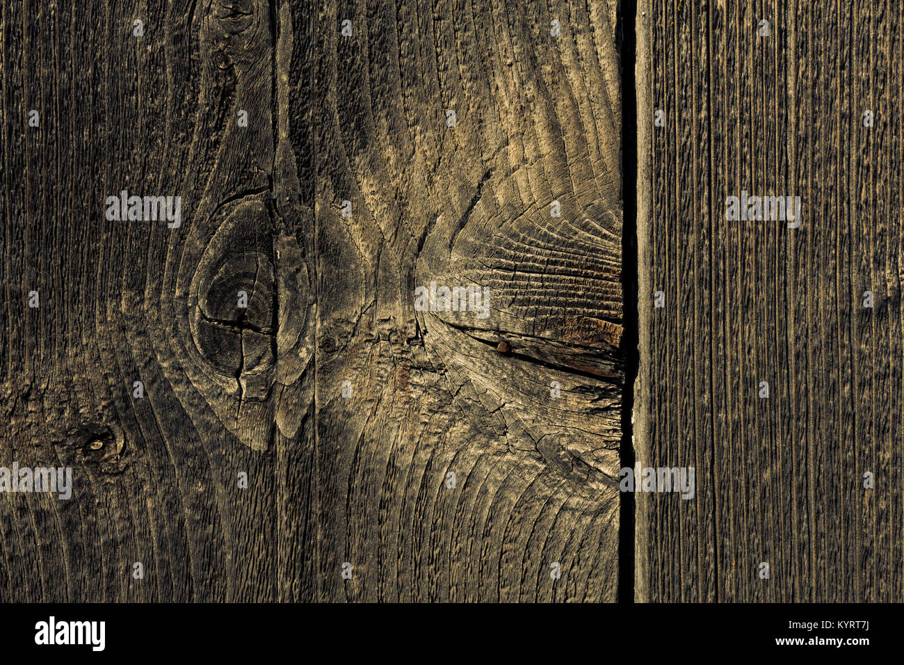 Part of old wooden door of abandoned house in mountain village in mainland Greece. The wood planks have natural - Stock Image