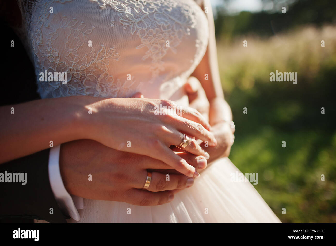 Romantic Wedding Couple Hugging And Holding Hands In The Countryside Stock Photo Alamy