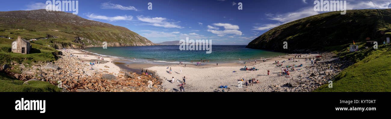 Panoramic view of holidaymakers in the sun onthe beach at Keem Bay, Achill Iland on the west coast of Ireland - Stock Image