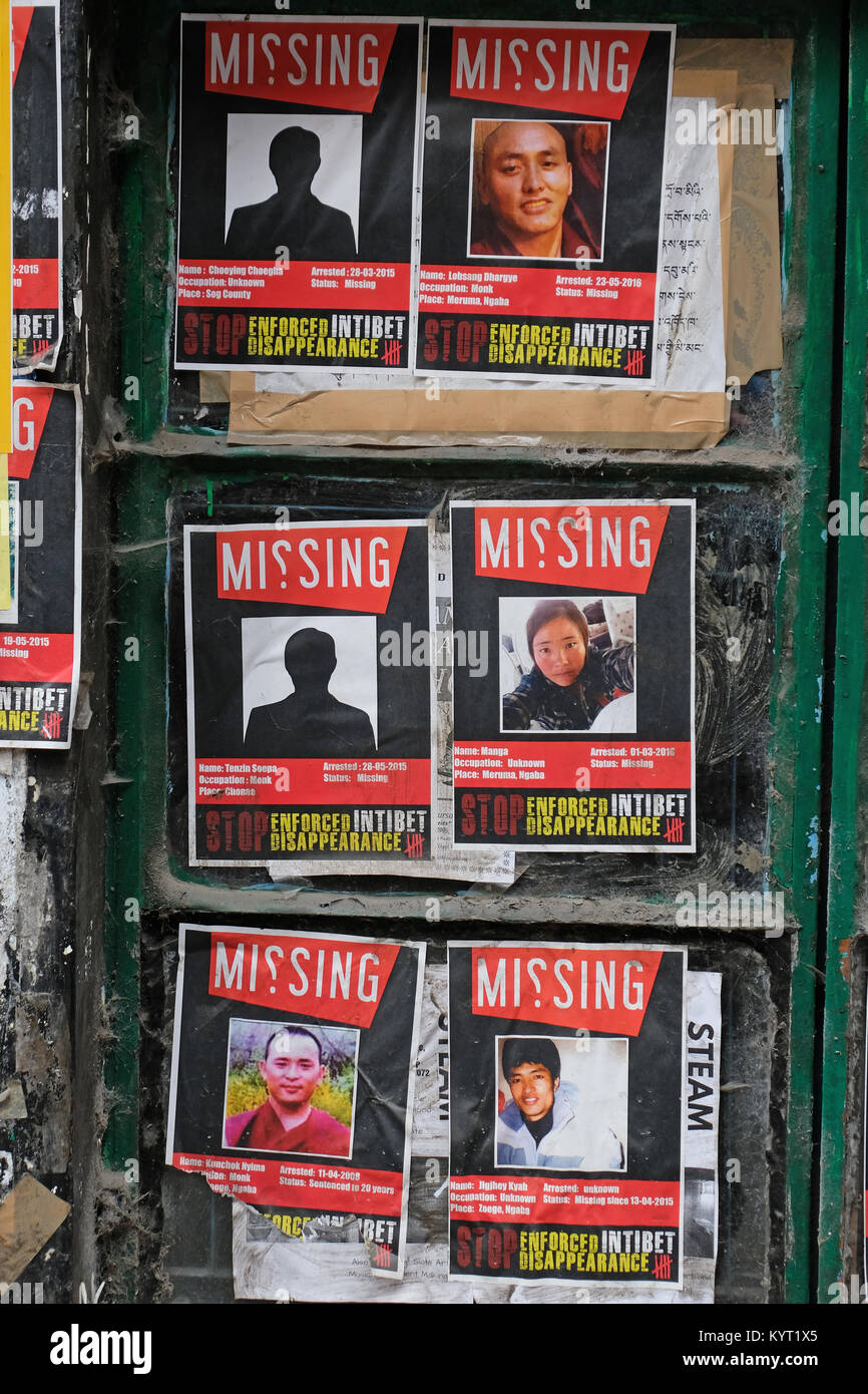 Posters of missing Tibetan activists, posted in Dharamshala, India, the home of The Tibetan Government in Exile - Stock Image