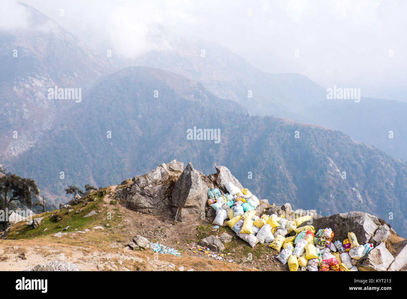 Trekker's waste piled up in plastic sacks in the Himalayan foothills, India - Stock Image