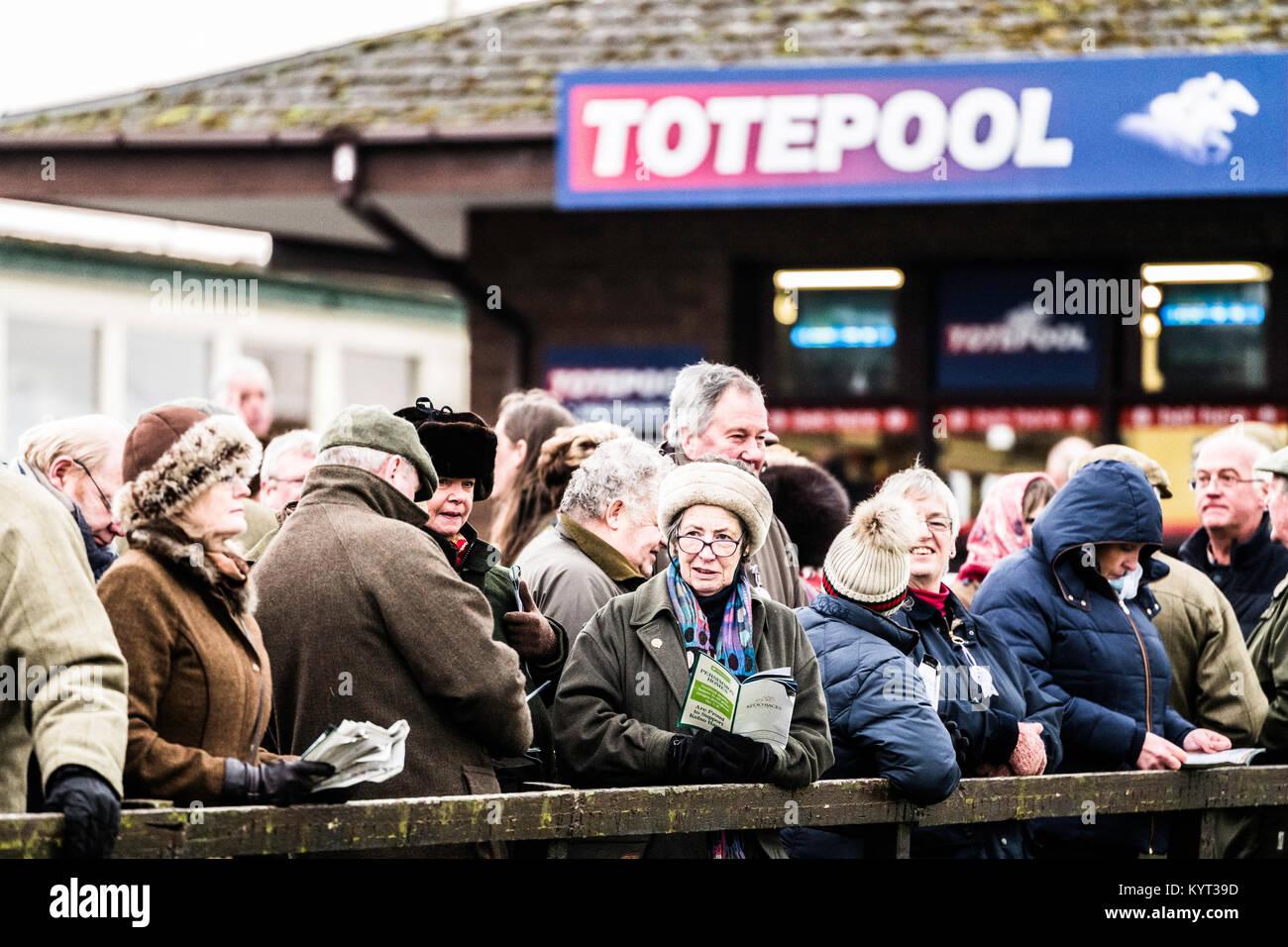 Kelso, Scottish Borders, UK. 14th January 2018. Spectators study form at Kelso Races. - Stock Image