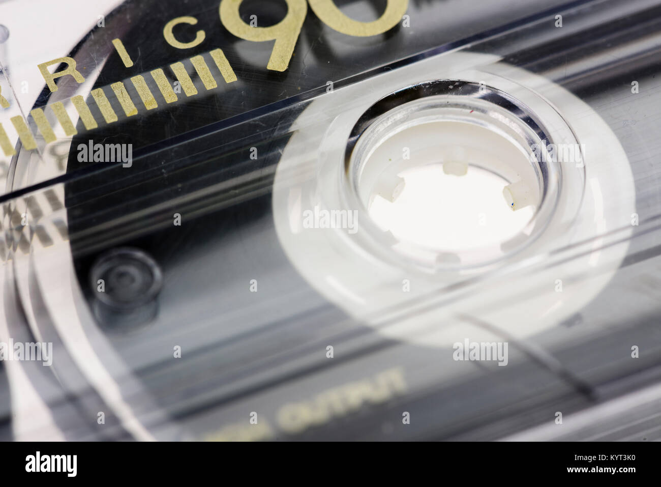 Spindle of an old fashioned cassette tape. - Stock Image