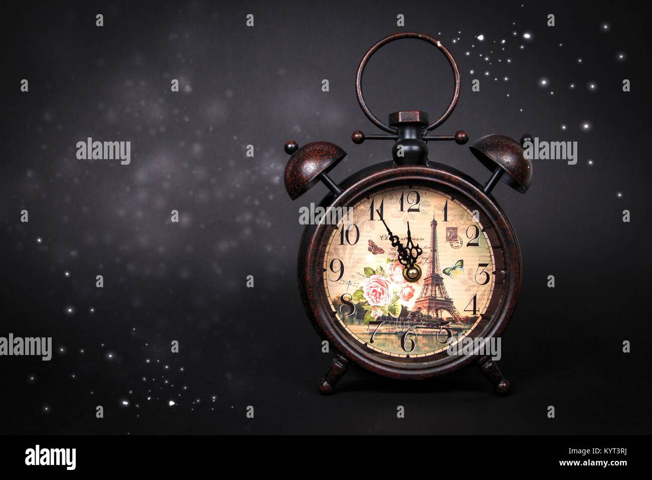 Photo Of An Old Vintage Clock On Black Background With Sparkles And Stars