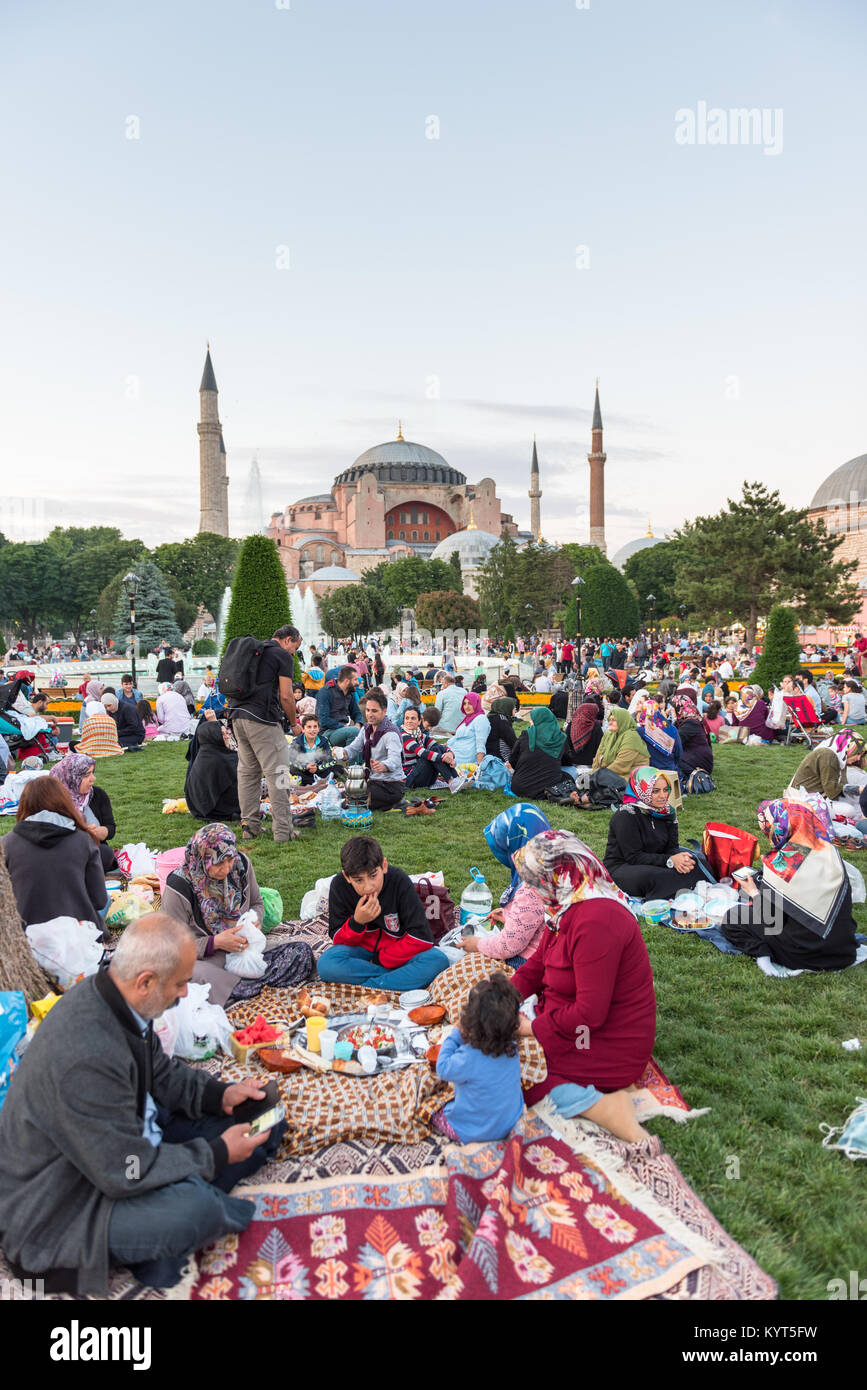 Muslim people who are fasting wait for the adhan (ezan) and evening meal (Iftar) in Ramadan month in Sultan Ahmet - Stock Image