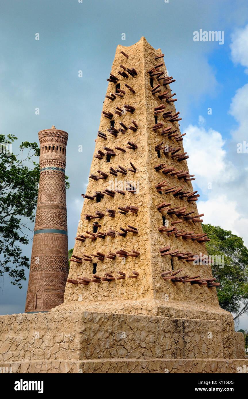 Replica of Great Mosqe of Agadez Niger & Kalyan Mosque Minaret, Uzbekistan at Islamic Heritage Theme Park, Kuala - Stock Image