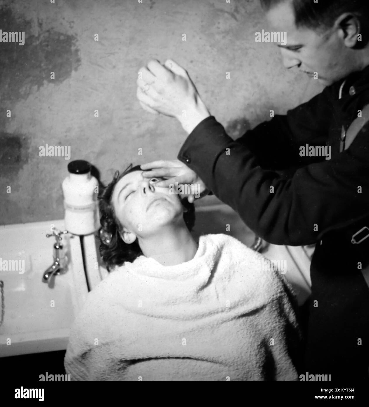 Giving treatment after a gas attack, ARP training exercise during WW2 - Stock Image