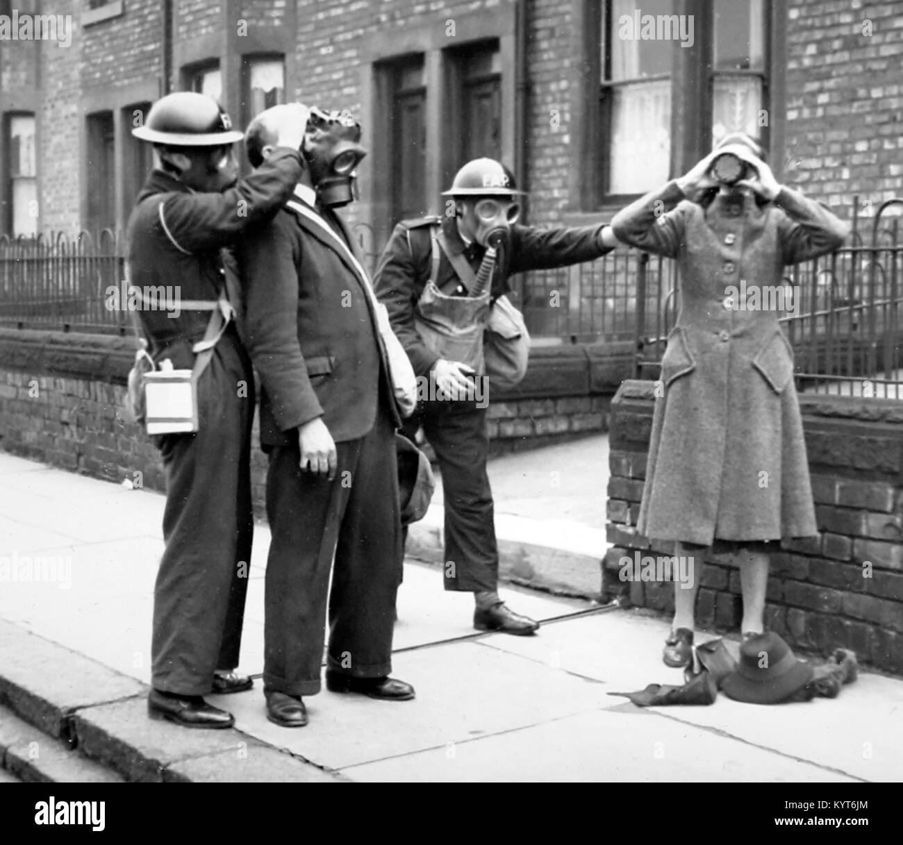 Helping to put on gas masks, ARP training exercise during WW2 - Stock Image